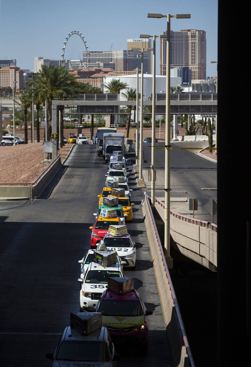 Taxis line up at McCarran International Airport ahead of the Labor Day holiday weekend in Las V ...