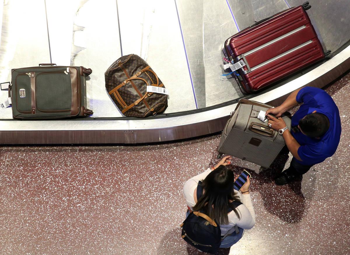 Passengers at Terminal 1 baggage claim at McCarran International Airport in Las Vegas, Wednesda ...