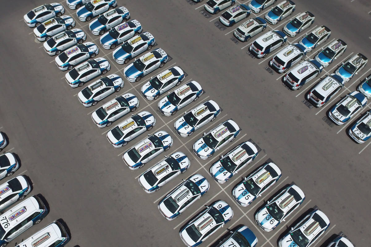 Taxis sit in a parking lot of Nellis Cab Company on Thursday, May 7, 2020, in Las Vegas. Taxi r ...