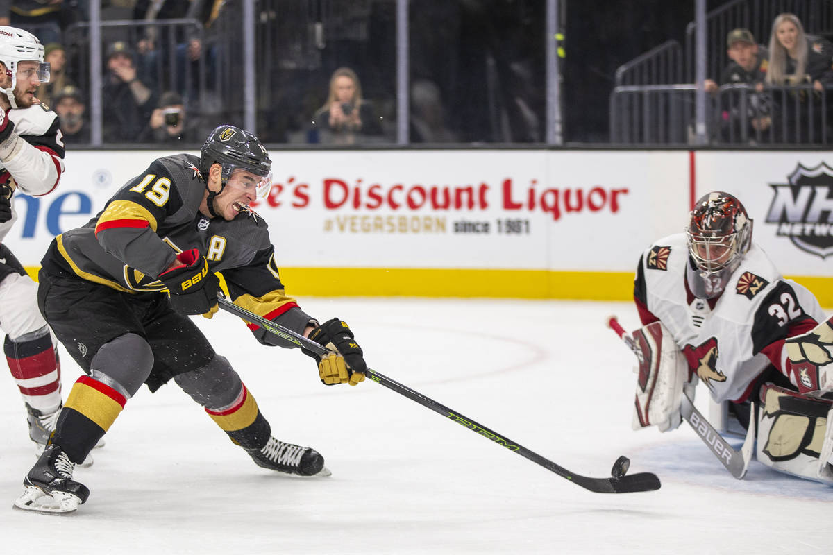 Vegas Golden Knights right wing Reilly Smith (19) sends a shot attempt on Arizona Coyotes goalt ...