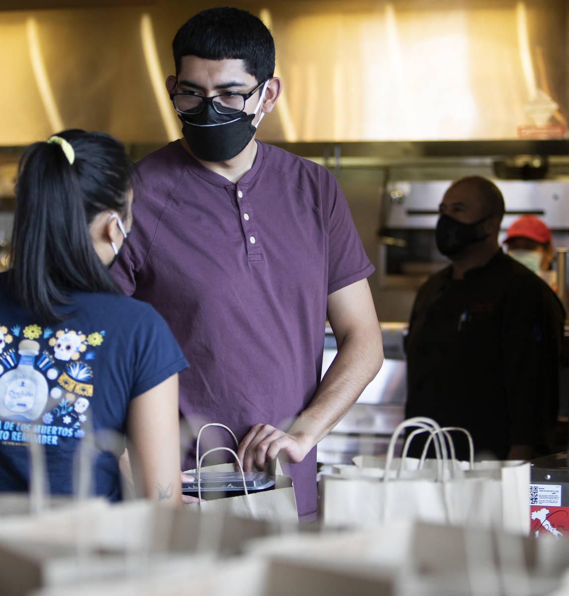 Anthony Campos talks with fellow employee Juliana Asa at Nora's Italian Cuisine on Wednesday, M ...
