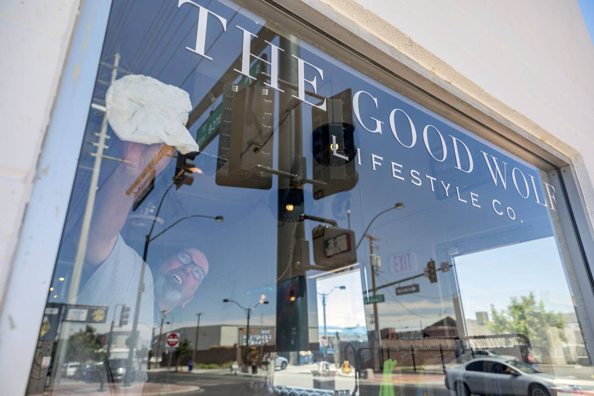 Erik Cerza, owner of I Love Windows cleaning company, cleans the windows at the Good Wolf Lifes ...