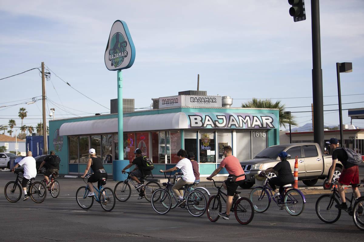 A group of bikers crosses Las Vegas Boulevard headed toward the Strip on Saturday, April 25, 20 ...