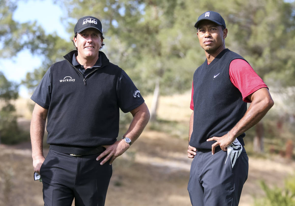 Phil Mickelson, left, and Tiger Woods stand at the first tee box before The Match at Shadow Cre ...