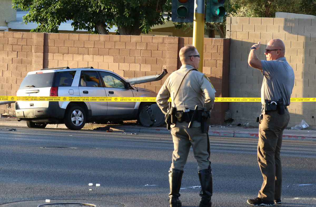 An SUV is seen at the scene of an accident where Las Vegas police is investigating after a pede ...