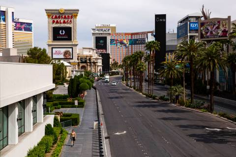 A man walks along the Las Vegas Strip on Thursday, April 16, 2020. (Chase Stevens/Las Vegas Rev ...