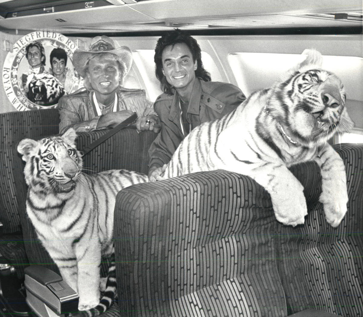 Siegfried and Roy pose for a photo with tiger cubs aboard and airplane in June 1987. (Review-Jo ...