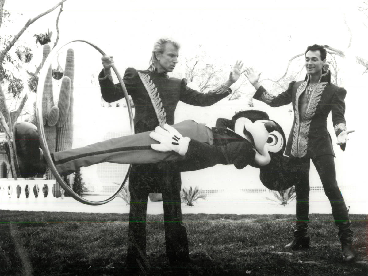 Siegfried and Roy perform a magic trick with Mickey Mouse. (Review-Journal file)