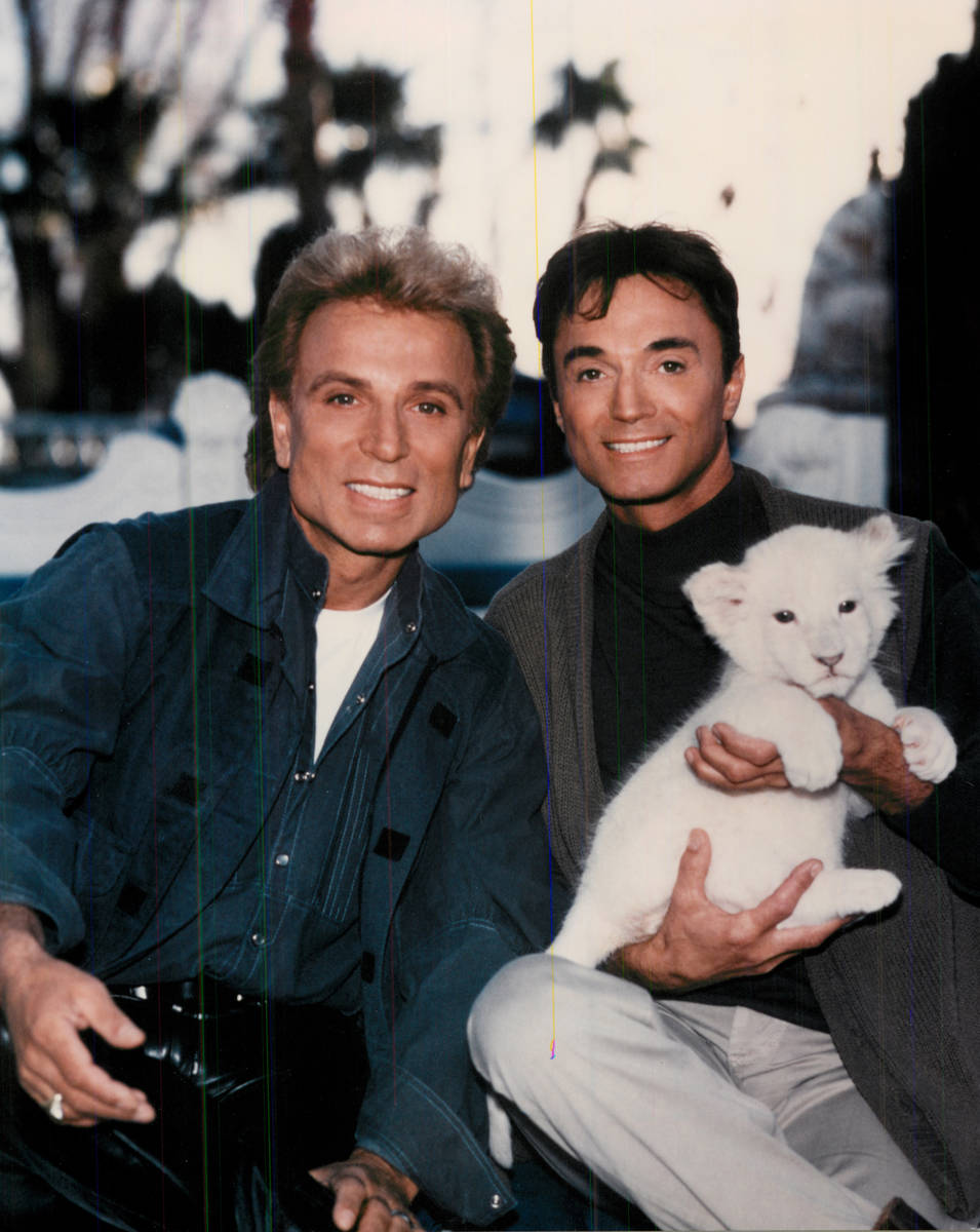 Siegfried and Roy with a tiger cub. (Review-Journal file)