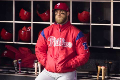 Philadelphia Phillies' Bryce Harper watches a video tribute from the dugout before a baseball g ...
