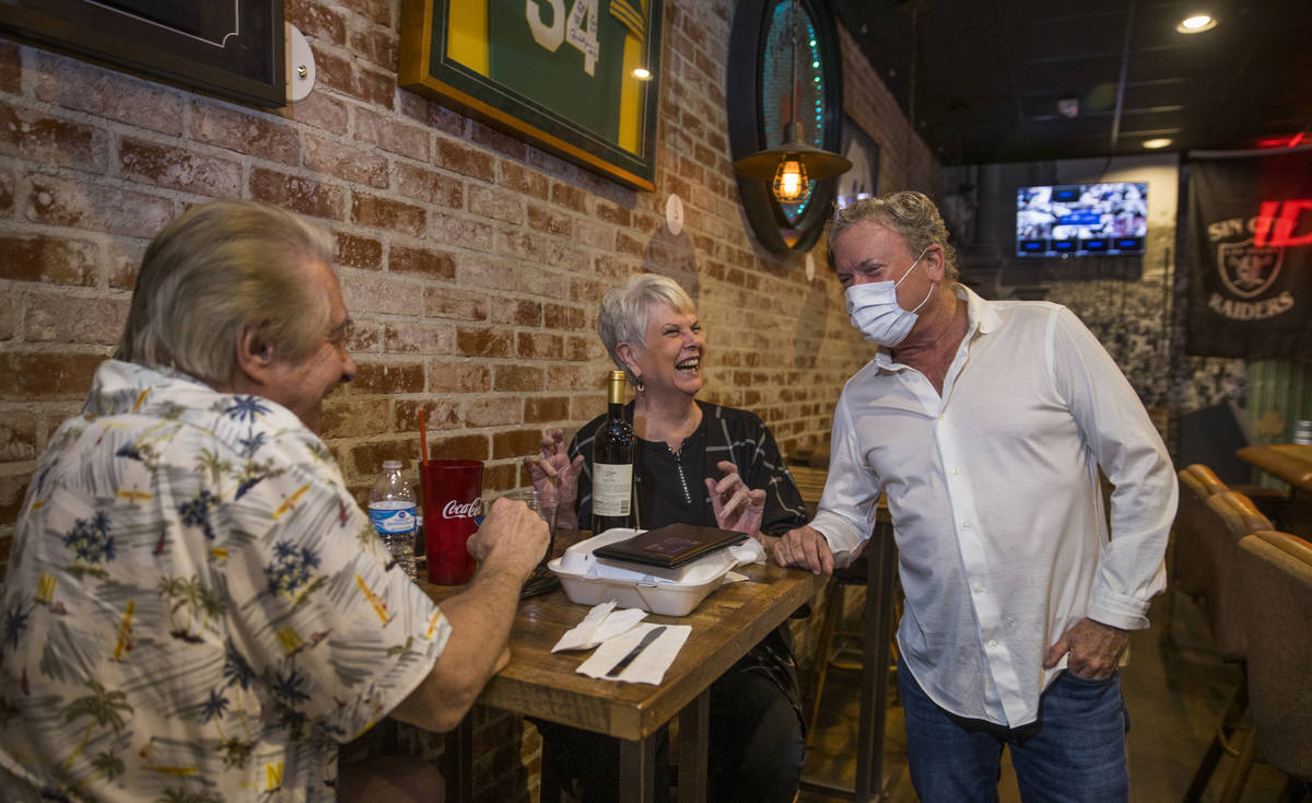 Customers Larry, left, and Lin Meriage share some laughs with Johnny Mac's Sports Bar & Gri ...