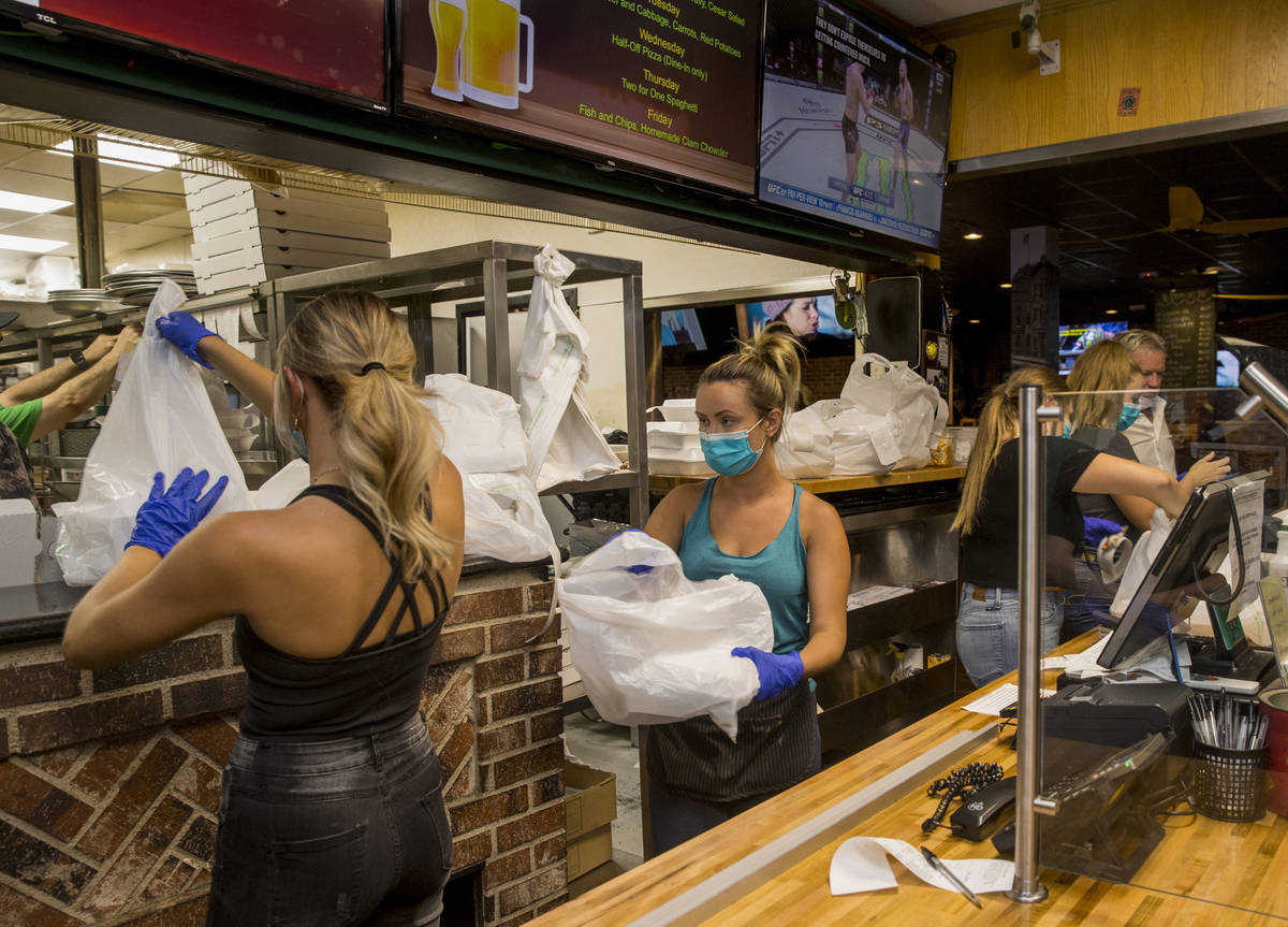 The front counter at Johnny Mac's Sports Bar & Grill has stayed busy but picking up more as ...