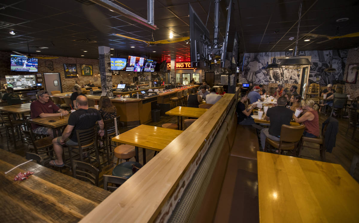 The dining area is spaced with empty tables at Johnny Mac's Sports Bar & Grill now open aga ...