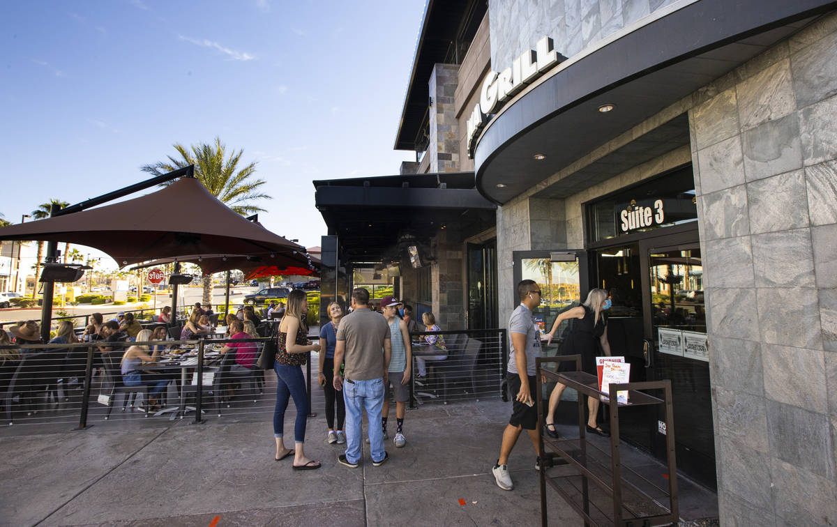 People wait for a table at Kona Grill in Boca Park as some restaurants open for table-service i ...
