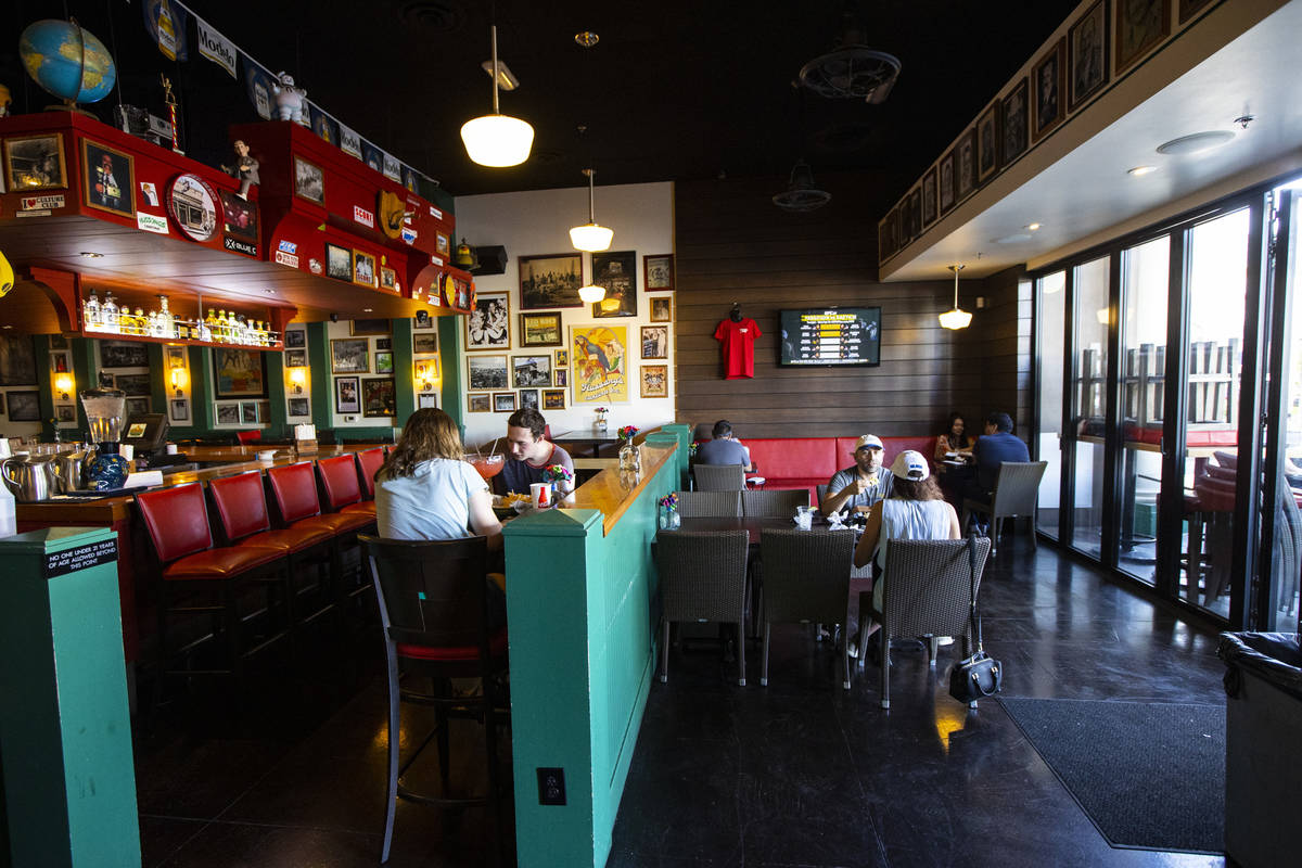 People dine at Hussong's Cantina in Boca Park as some restaurants open for table-service in Las ...