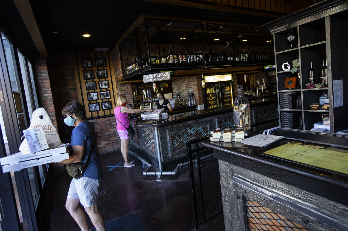 A customers stops by for a pickup order at Grimaldi's in Boca Park as some restaurants open for ...