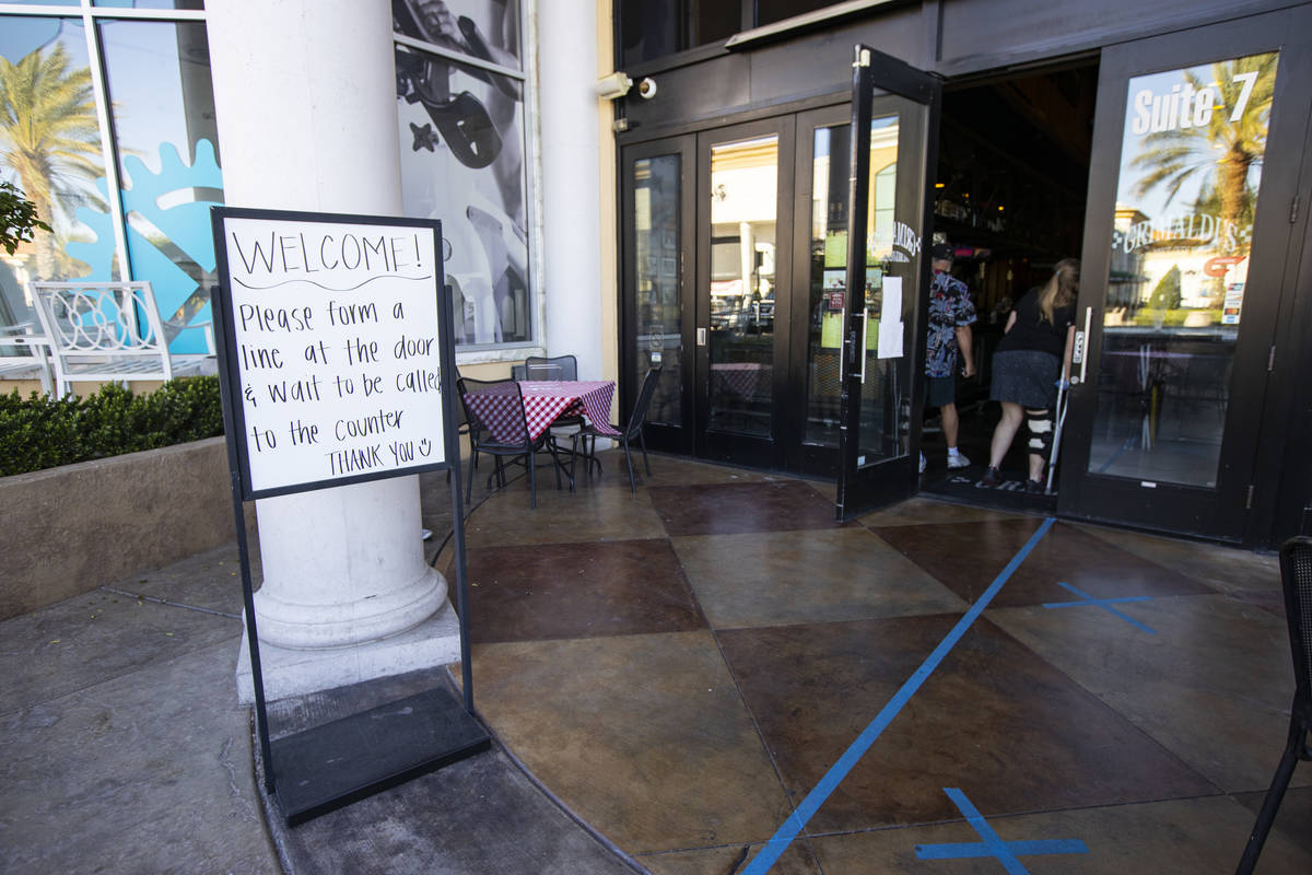 A sign directs customers at Grimaldi's in Boca Park as some restaurants open for table-service ...