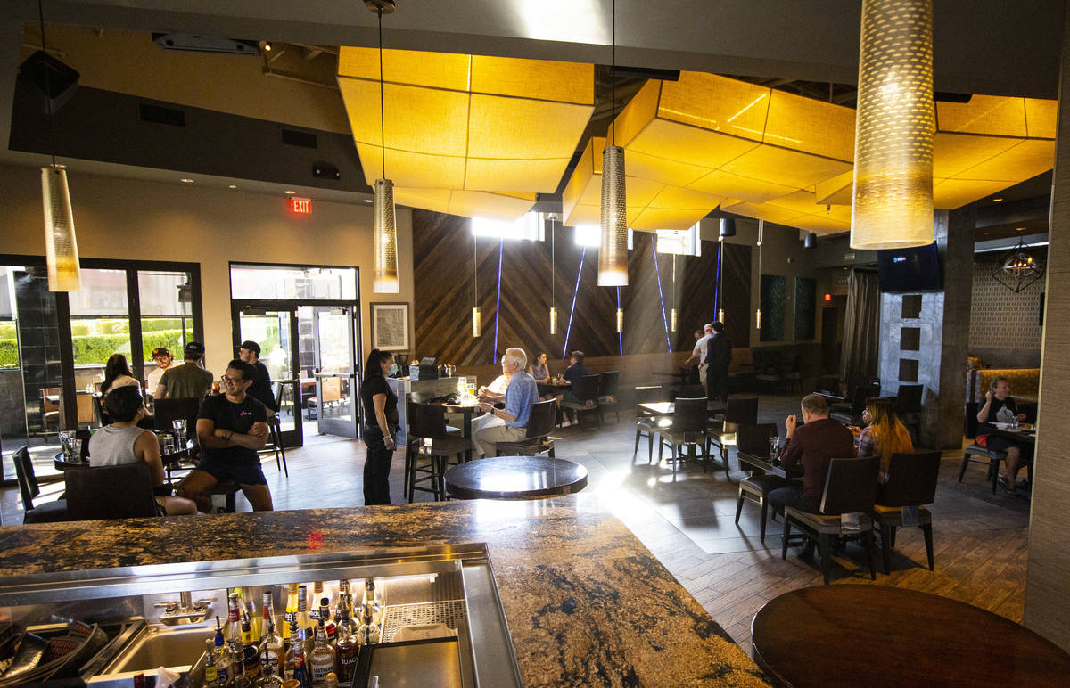 People dine at Kona Grill in Boca Park as some restaurants open for table-service in Las Vegas ...