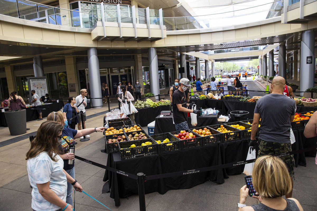 People stop by the Las Vegas Farmers Market at Downtown Summerlin in Las Vegas on Saturday, May ...