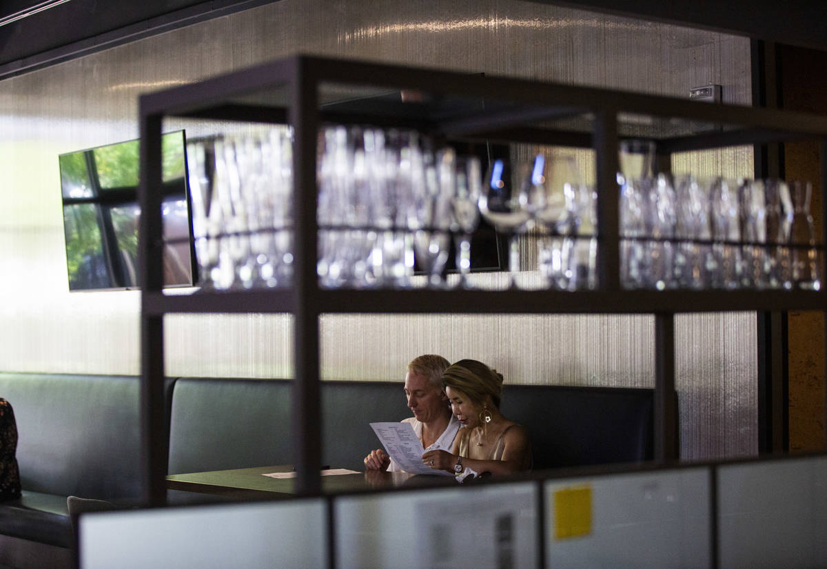 People dine at Wolfgang Puck Players Locker as some restaurants open up for table-service at Do ...