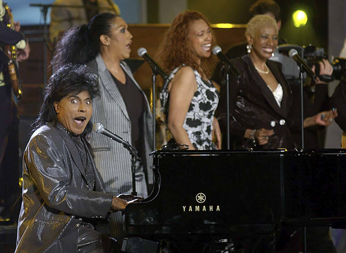 """In this April 21, 2002 file photo, Little Richard performs """"Good Golly Miss Molly"""" with the Poi ..."""
