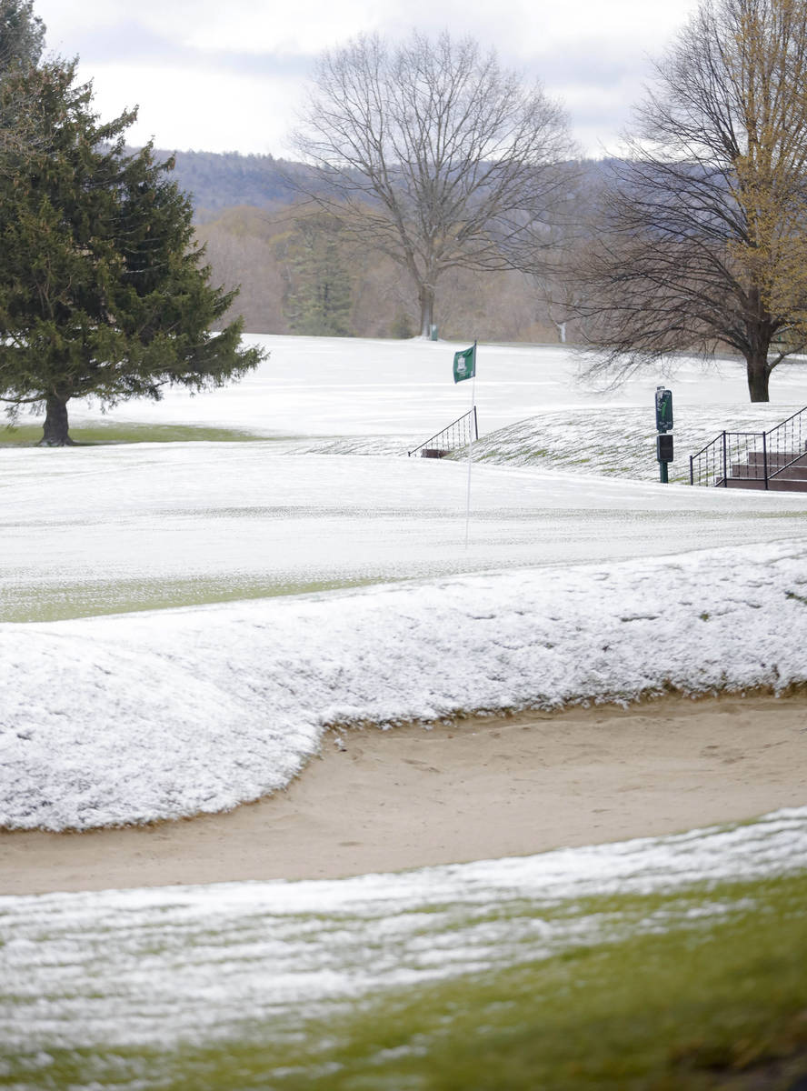 The greens and fairways are covered in snow, just as golf courses were starting to open for the ...