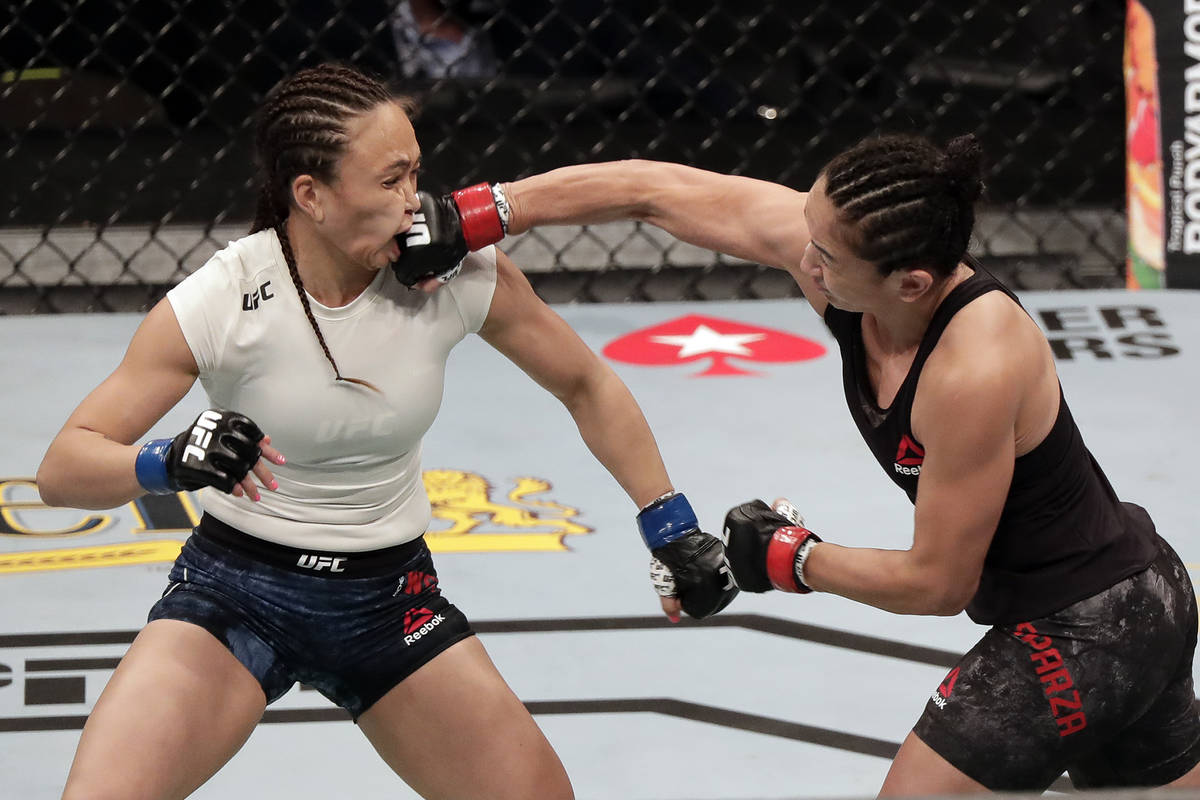 Carla Esparza, right, lands a punch on Michelle Waterson during a UFC 249 mixed martial arts bo ...