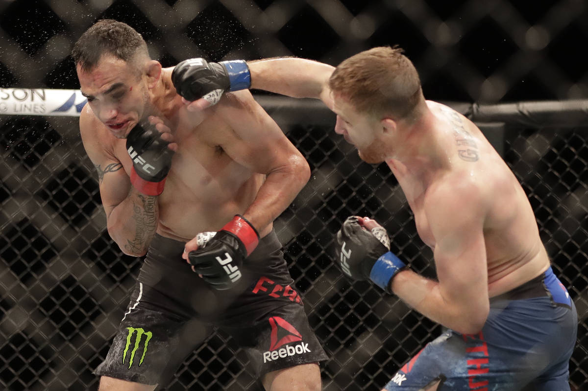 Justin Gaethje, right, punches Tony Ferguson during a UFC 249 mixed martial arts bout, Saturday ...