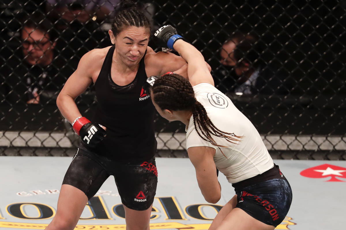 Carla Esparza, left, fights Michelle Waterson during a UFC 249 mixed martial arts bout Saturday ...