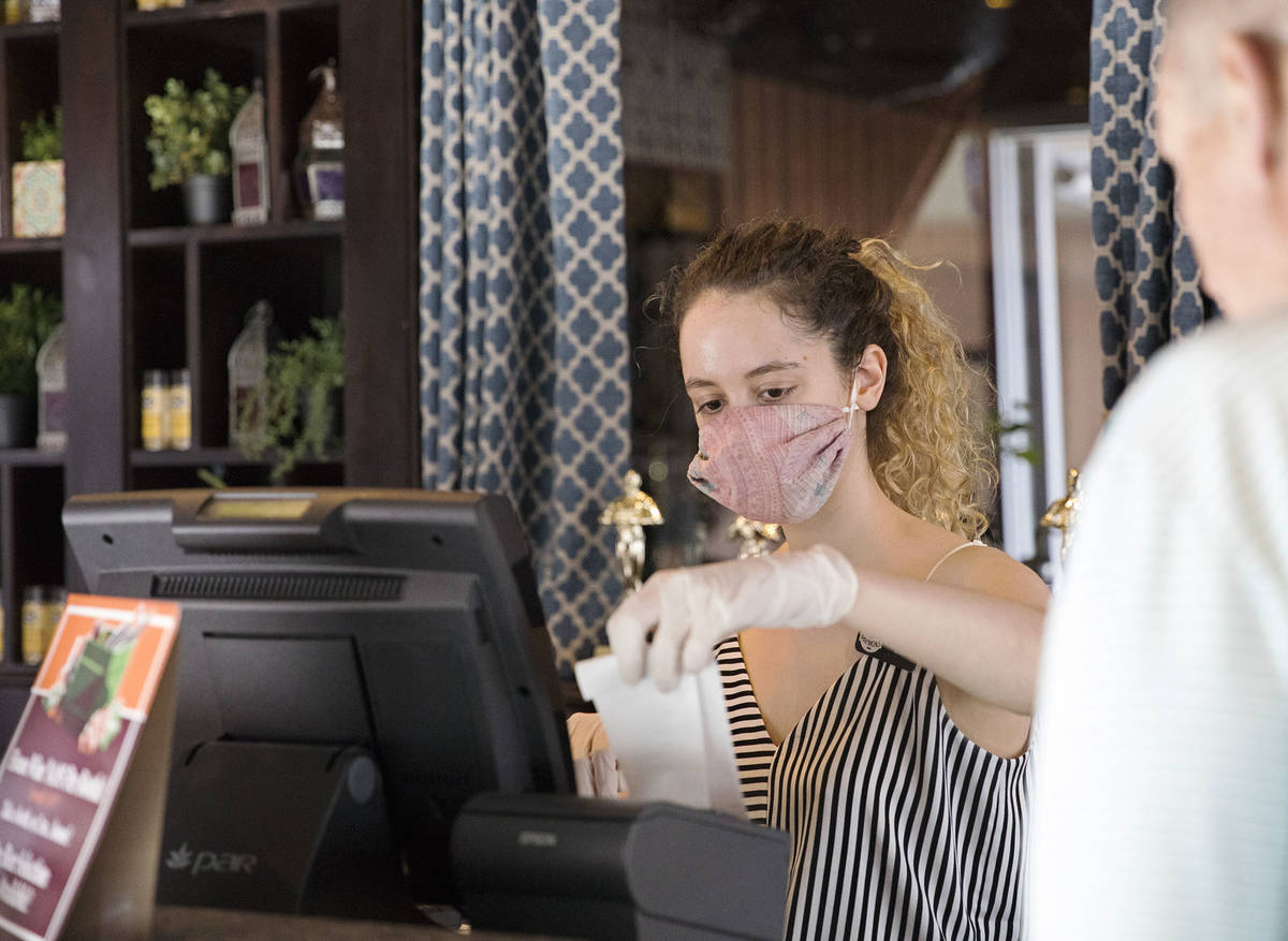 Clea Ciccone helps a customer at Paymons, a Mediterranean restaurant, in Las Vegas, Sunday, May ...