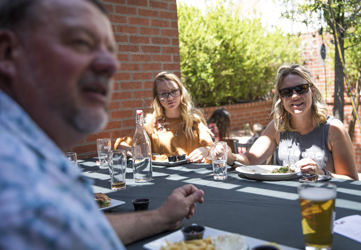 Mike Scronce, far left, has brunch with his wife, Yolanda Scronce, right, and their daughter Tr ...