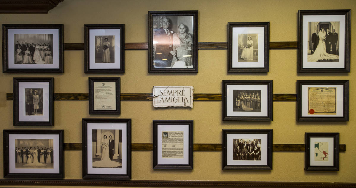 Owner Dan Thompson proudly displays his Italian family heritage on the wall near the kitchen at ...