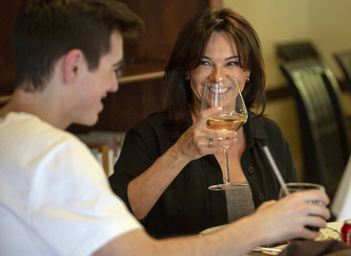 Diners Seth Andress, left, and his mother Lou talk toast to a delicious Mother's Day dinner at ...