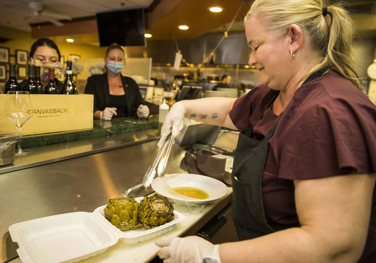 Brandi Thompson prepares some stuffed artichokes for a takeout order at D'Agostino's Trattoria ...