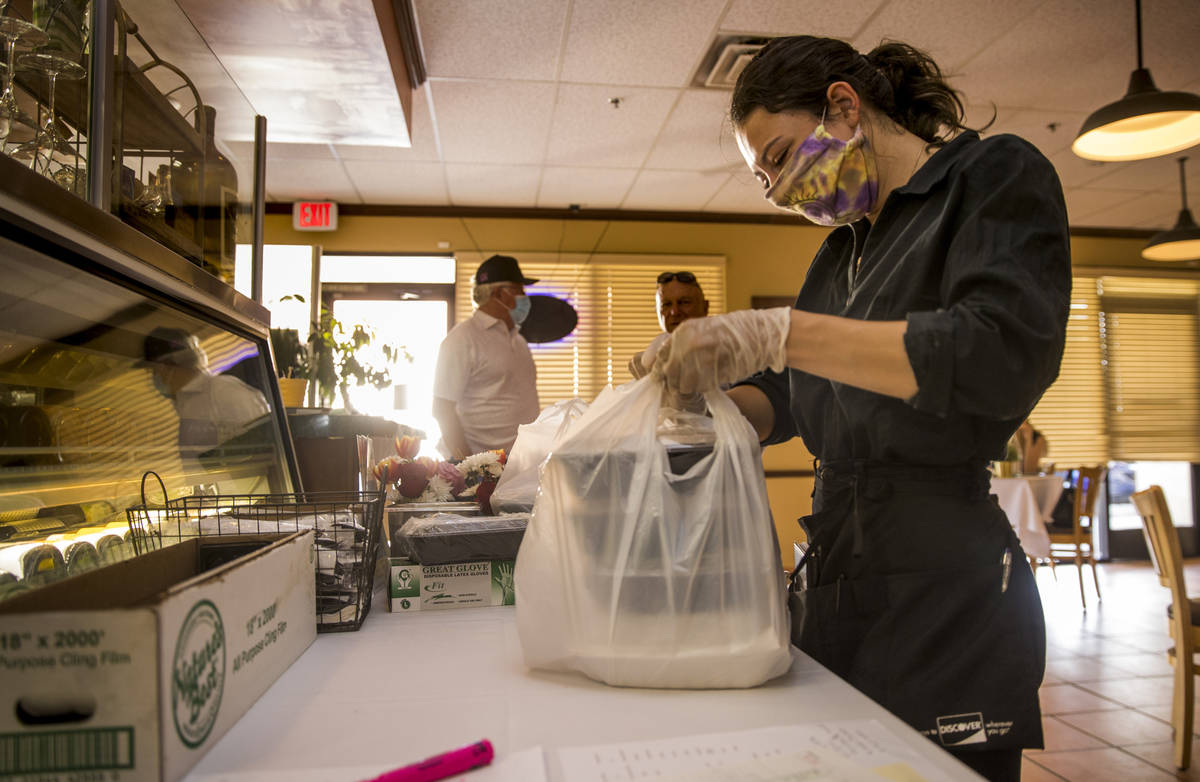 ServerCaroline Passaretti prepares another Mother's Day takeout dinner at D'Agostino's Trattori ...