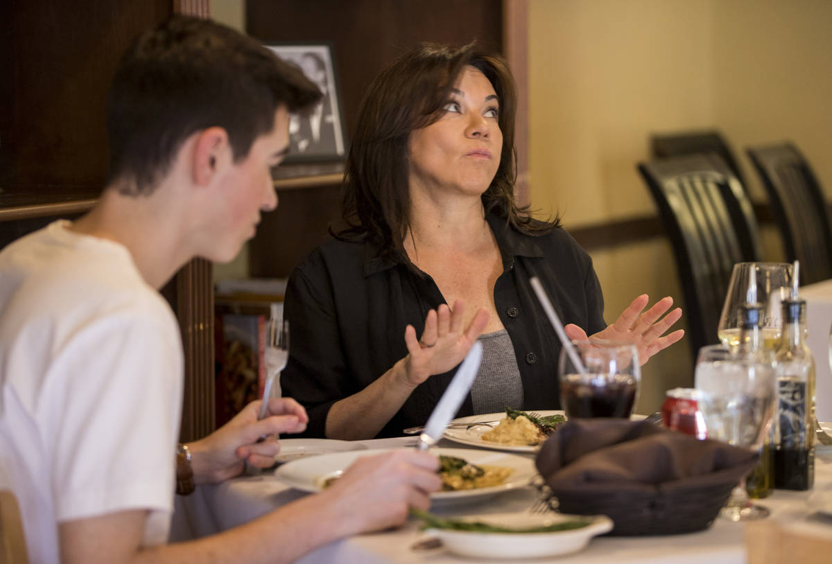 Diners Seth Andress, left, and his mother Lou talk about how delicious their entrees are to wai ...