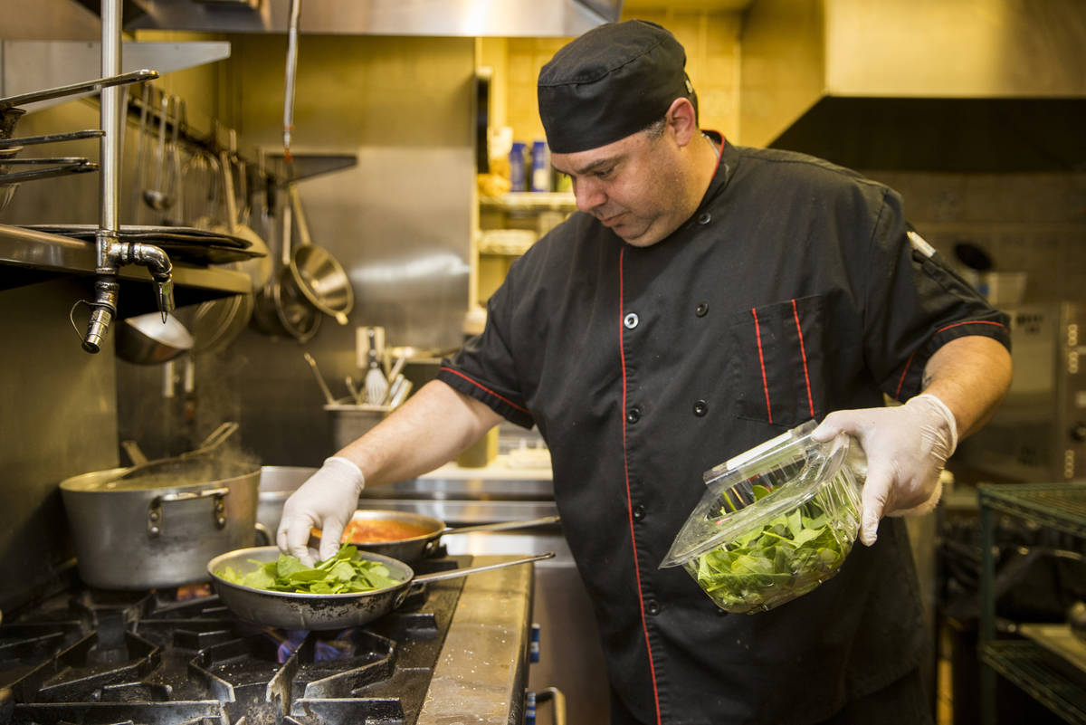Che and owner Dan Thompson prepares another dish in the kitchen at D'Agostino's Trattoria on Mo ...