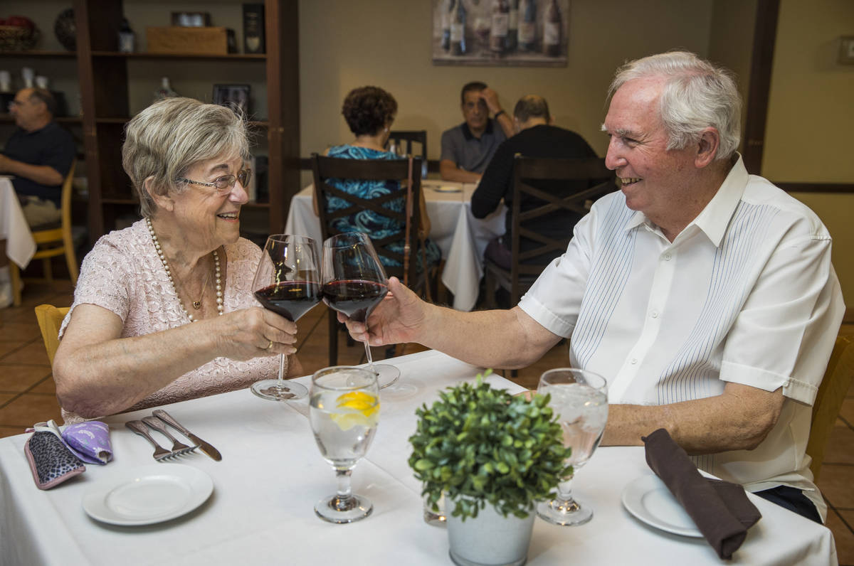 Peggy and Don Thompson share a toast a Mother's Day as they prepare to dine at D'Agostino's Tra ...