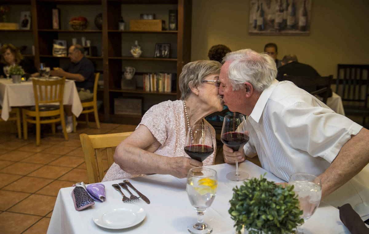 Peggy and Don Thompson share kiss after a toast for Mother's Day as they prepare to dine at D'A ...