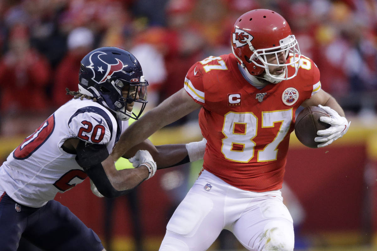 In this Jan. 12, 2020, file photo, Kansas City Chiefs tight end Travis Kelce (87) is tackled by ...
