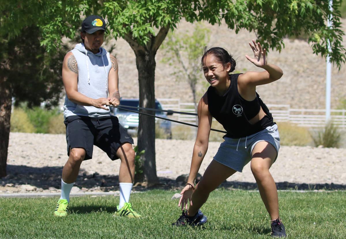 Liberty High School basketball player Raina Bitanga exercises with the help of her uncle Jonath ...