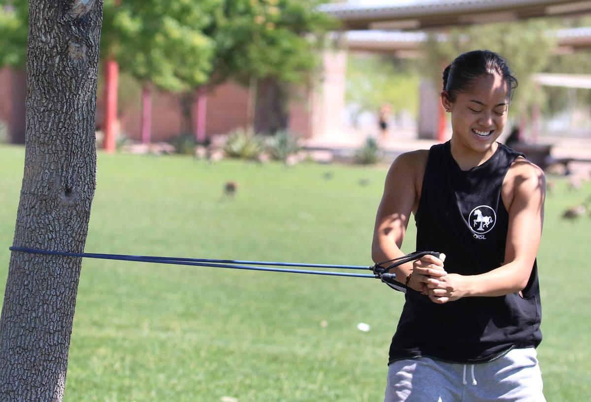 Liberty High School basketball player Raina Bitanga works out at Cornerstone Park on Monday, Ma ...