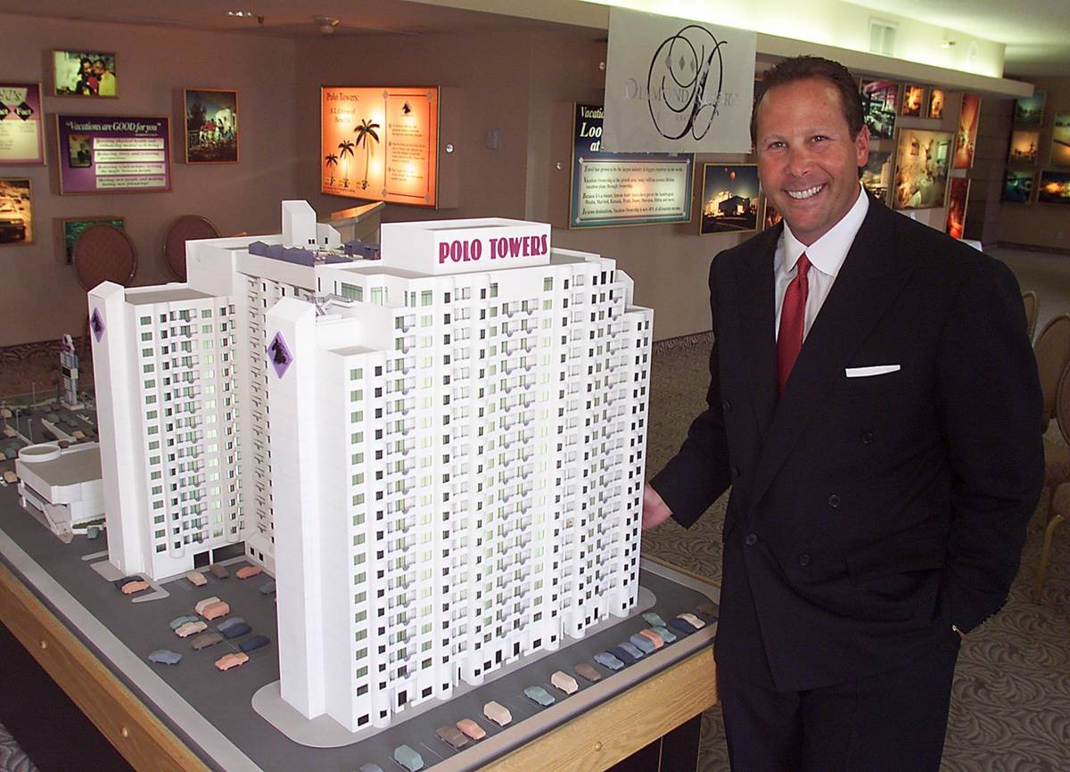 File photo of Stephen J. Cloobeck with model of a proposed tower at Polo Towers, one of his for ...