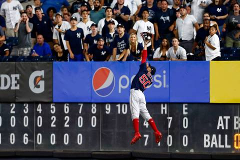 In this Sunday, Aug. 4, 2019, file photo, Boston Red Sox right fielder Mookie Betts makes a lea ...