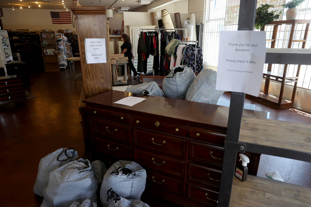 Dinosaurs & Roses Executive Director Michele Morgan, 60, loads donated items on the first d ...