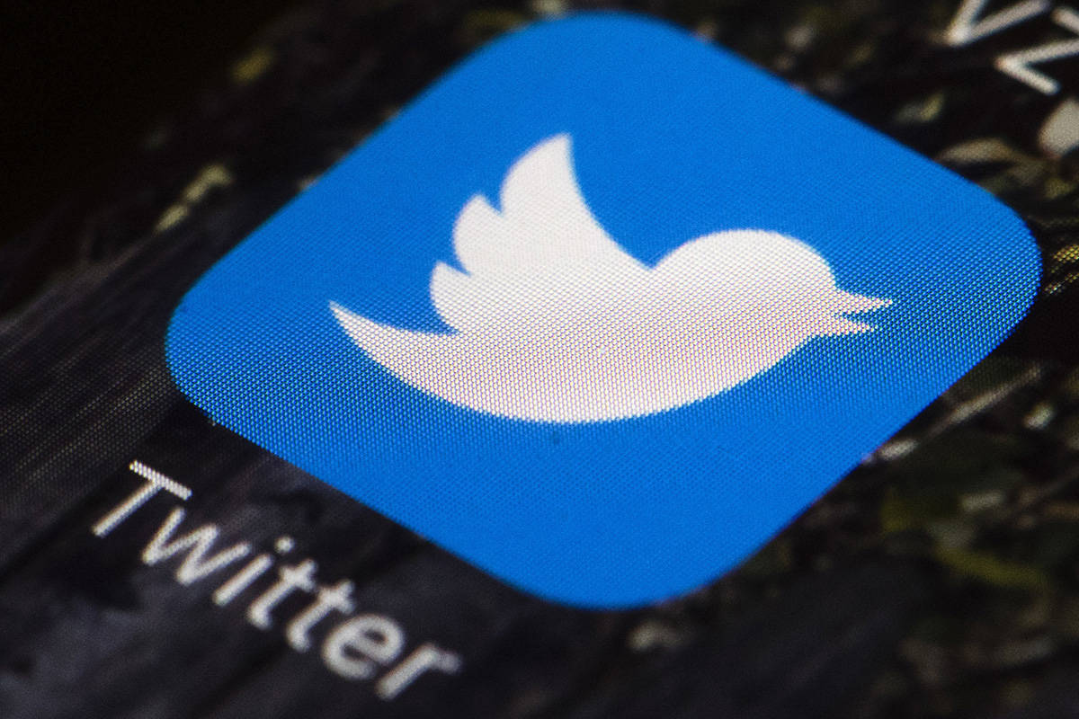 FILE - This April 26, 2017, file photo shows the Twitter app icon on a mobile phone in Philadel ...