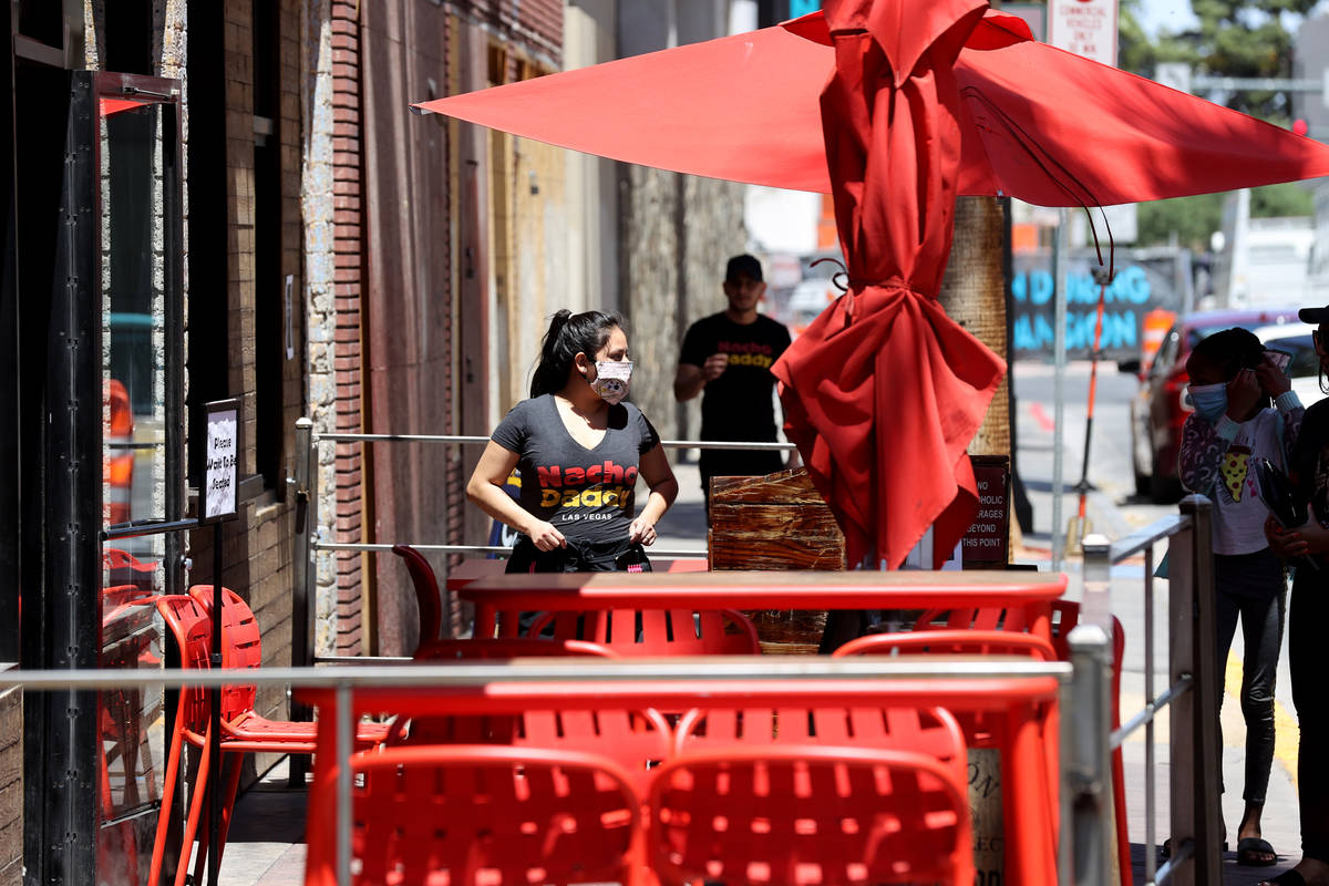 A Nacho Daddy prepares to seat a group at the restaurant on 4th Street in downtown Las Vegas Tu ...