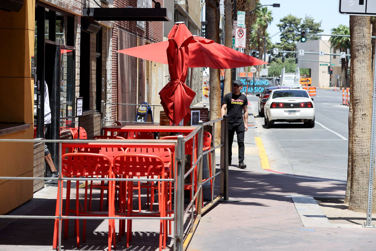 A Nacho Daddy worker arrives at the restaurant on 4th Street in downtown Las Vegas Tuesday, May ...
