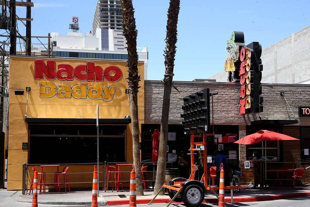 A Nacho Daddy worker returns after delivering a curbside order at the restaurant on 4th Street ...