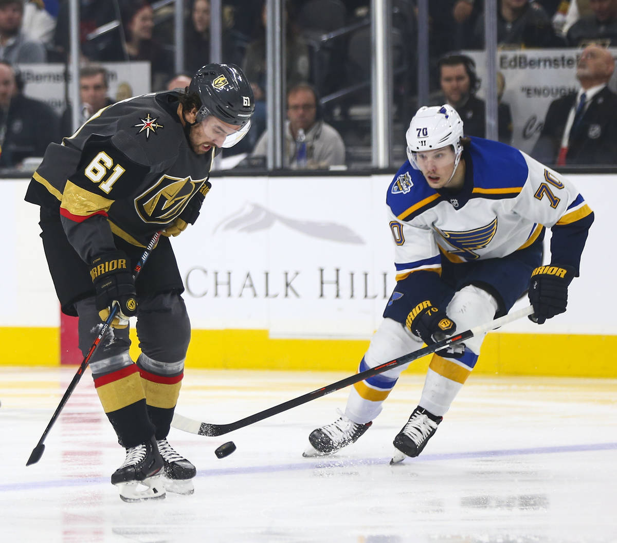 Golden Knights' Mark Stone (61) battles for the puck against St. Louis Blues' Oskar Sundqvist ( ...